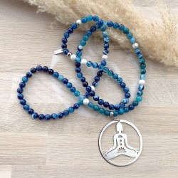 Sautoir perles bleues avec médaillon en forme de bouddha assis
